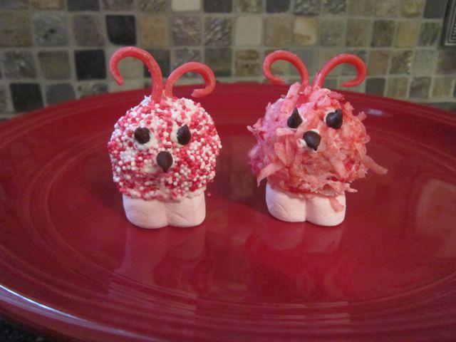 These donut holes Love Bugs are perfect for Valenti-ne's Day. They are fun, cute, and so easy for your kids to make. Here is a step-by-step tutorial.  #WomenLivingWell #ValentinesDay #donutholes #kidfriendly