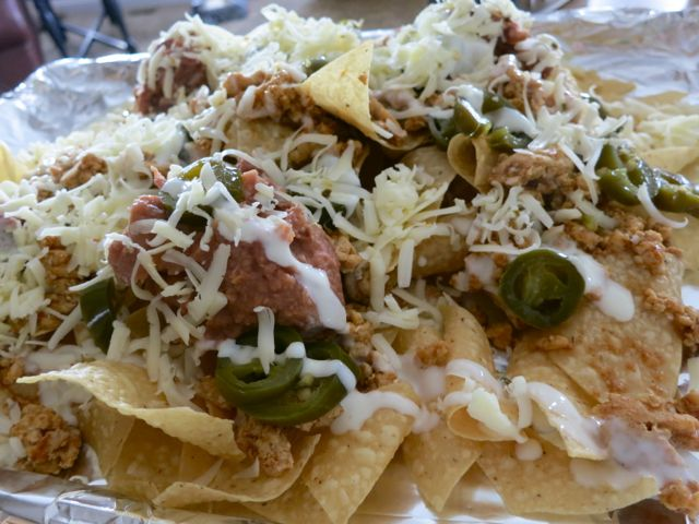 These are the very best loaded nachos and so fast and easy to make. They are a perfect tailgating and game day snack, or great for potlucks and movie nights. #WomenLivingWell #nachos #gamedayfood #easyrecipe