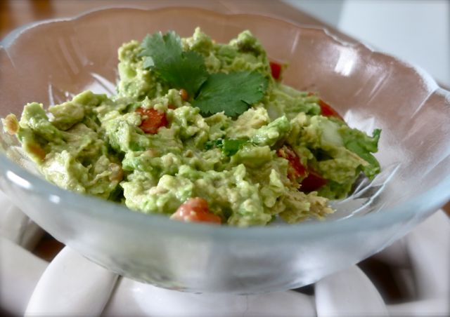 This homemade guacamole recipe is better than what you'll get in the restaurant! It's so easy to make and keeps you coming back for more. #WomenLivingWell #guacamole #mexican #nachos