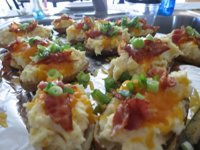 These twice baked potatoes are easy to make and the most delicious ones you'll try. Cheese, sour cream, bacon and a secret ingredient for the ultimate yum! #easyrecipe #potato #sidedish